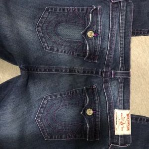 Size 34 True Religion jeans with purple stitching